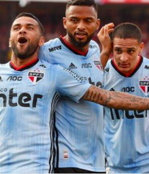 Alves (left) played as a midfielder on Sunday