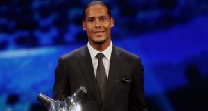 Virgil van Dijk beats Messi, Ronaldo for the UEFA Champions award.jp2