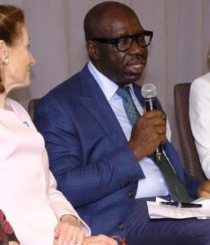 Obaseki with microphone with other World Bank officials