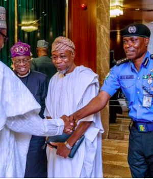 President Buhari shakes hands with IGP Mohammed Adamu, with them is Muslim Smith and Rauf Aregbesola, Internal Affairs minister