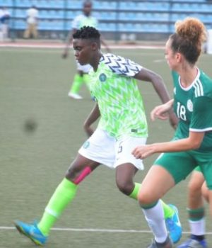 Super Falcons Ohale Marvis been sandwiched by her Algeria counterparts