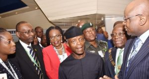 VP Yemi Osinbajo listens to FistBank's Group CEO, Dr. Adesola Adeduntan