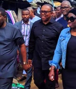 Obi (middle), flanked by Sen. Uche Ekwunife (right) and Hon. Chris Azubogu (left), during their visit to the parts of Onitsha market affected by fire