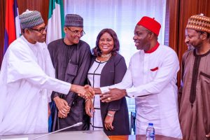 President Buhari shakes hands with Prof. Soludo with other Economic Advisory Committee members