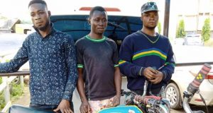 Emmanuel Michael with two other robbery suspects