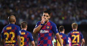 Suarez double saves Barca from Inter Milan assault