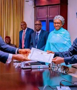 NCP Chairma and VP Prof. Yemi Osinbajo handing over Certificate of Discharge to Tony Elumelu of Transcorp Hotels Plc