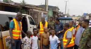 LAWMA officials parade arrested residents for unlawful waste disposal