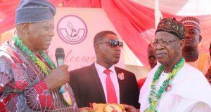 Adebayo (left), conferring a Merit Award on Lai Mohammed