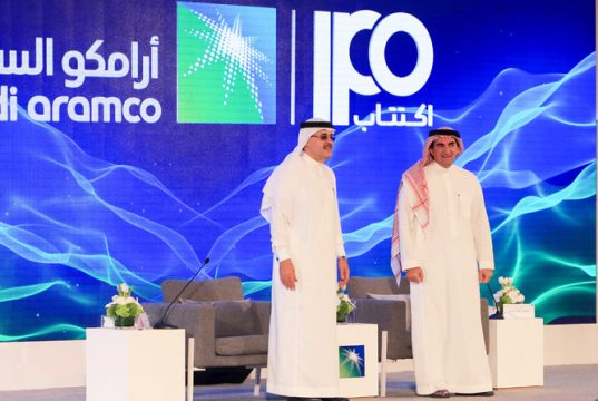 President and CEO of Saudi Aramco Amin Nasser (L) and Aramco's chairman Yasir al-Rumayyan