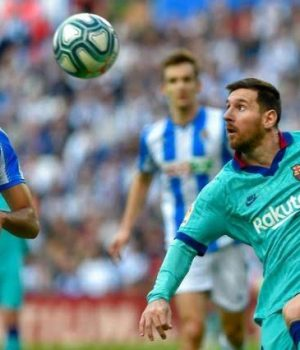 Barca's Lionel Messi confront Real Sociedad players