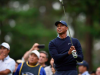 Tiger Woods plays a tee shot on the 7th hole during The Challenge: Japan Skins golf competition