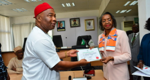 May Agbamuche-Mbu, INEC national commissioner presents certificate to Gov. Hope Uzodinma