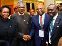 President Buhari in a hand shake with Elumelu and Lagos Gov. Babajide Sanwo-Olu