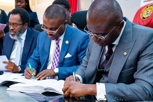 Gov. Sanwo-Olu and others sign the N100bn bond