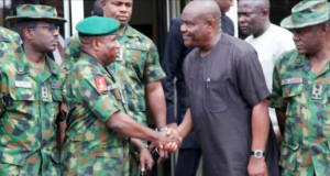 Gov. Nyesom Wike with soldiers in PortHarcourt
