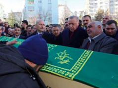 Turkish President Recep Tayyip Erdogan (centre-right) attends the funeral of some of the victims in Elazig