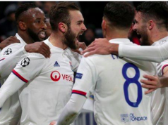Lyon players celebrate their loan goal against Juventus