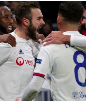 Lyon players celebrate their loan goal against Juventus