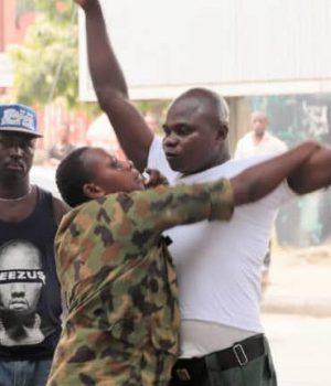 A soldier harassing a Lagos official