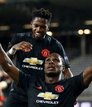 Odion Ighalo and team mate celebrate
