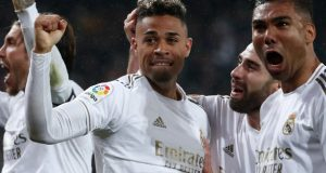 Real Madrid players celebrate victory over Barca