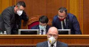 Ukraine's Prime Minister Denys Shmygal, wearing a protective mask used as a preventive measure against coronavirus disease