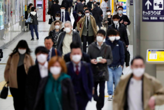 Passengers wearing protective face masks, following an outbreak of the coronavirus disease