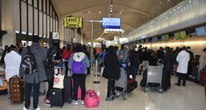 The evacuees checking in before their departure from the Newark Liberty International Airport, New Jersey, on Saturday evening. Photo: Harrison Arubu/NAN