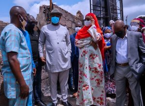 Festus Keyamo (SAN) HMS Labour, Sadiya Umar Farouq, HM, FMHDSD, a trader Mrs. Okolie and DG NEMA, AVM Muhammadu Alhaji Muhammed (Rtd.) during her visit to Ogbeogonogo market Asaba (Source Ministry