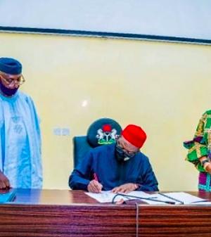 Gov. Fayemi signs the bill