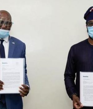 Lagos and USAID delegate display the agreement on power generation