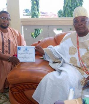 Chief Akintona receiving his chieftaincy certificate from Alake