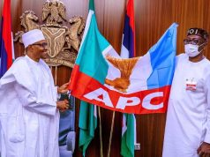 President Buhari hands over the flag to Pastor Osagie Ize-Iyamu