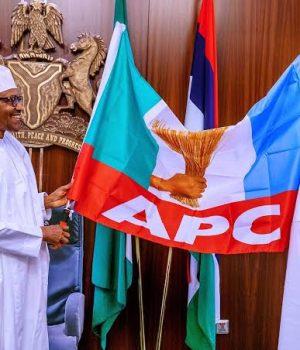 President Buhari hands over the flag to Pastor Osagie Ize-Iyamu