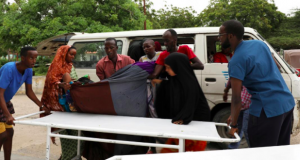 Civilians assist an injured person at Madina hospital after a blast at the Elite Hotel in Lido beach in Mogadishu, Somalia August 16