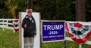 Signs supporting U.S. President Donald Trump stand in the front yard of a home in Bainbridge