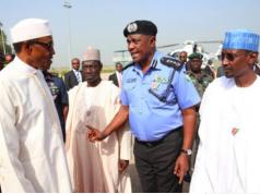 President Buhari and ex-IGP Solomon Arase