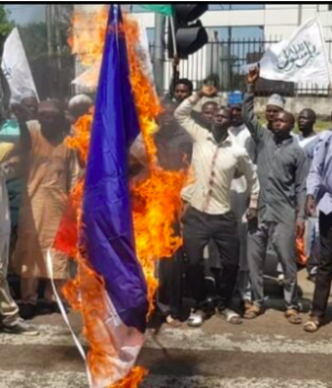 IMN protesters burnt France flag