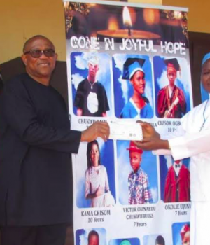 Rev. Sr Udechukwu Chidimma (right), receiving a cheque of N1 million Naira on behalf of Presentation Nursery and Primary school, Awgbu, from Peter Obi