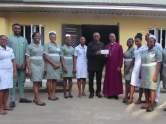 Bishop Ephraim Okechukwu Ikeakor receiving N1m cheque from Peter Obi