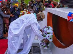 Gov. Babajide Sanwo-Olu laying the wreath