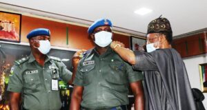 Lai Mohammed decorating his Orderly, ASP Lucky Moses