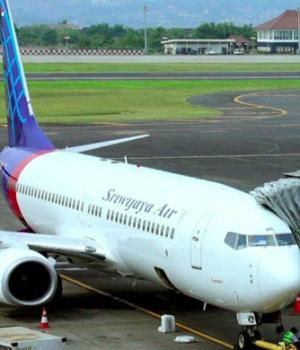 A 2009 photo of a Sriwijaya Air plane on the runway in Jakarta
