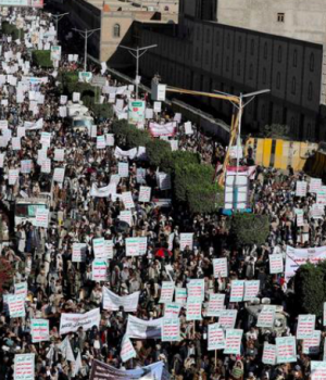 Houthi supporters rally against the United States' designation of Houthis as a foreign terrorist organisation