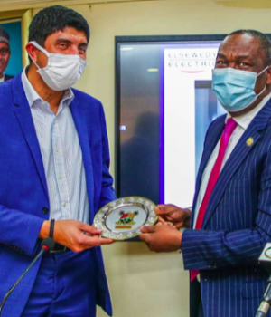Dr. Kadri Obafemi Hamzat (right) presenting a souvenir to Chief Commercial Officer/Group Vice President, Africa, Elsewedy Electric, Mr. Mohammed Atef