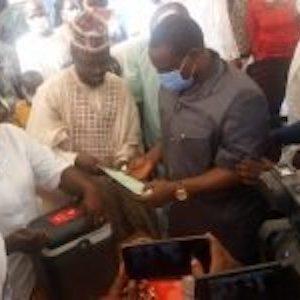 Kogi Commissioner for Health, Dr Saka Audu, handing over the COVID-19 vaccination card to the ED, KSPHCDA, Dr Abubakar Yakubu