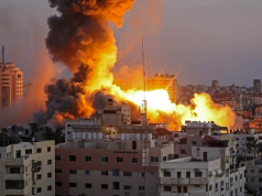 Smoke billows above buildings after an Israeli airstrike on Gaza City in the Gaza Strip early on May 15, 2021.