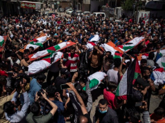 Palestinians attend the funeral of two women and eight children of the Abu Hatab family in Gaza City