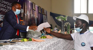 NDDC Interim Administrator, Efiong Akwa, presenting a certificate to the